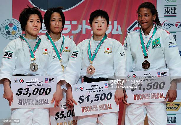 Silver medalist Aiko Sato bronze medalists Ansu Yamamoto and Rafaela Silva of Brazil and gold medalist Kaori Matusmoto of Japan pose for...