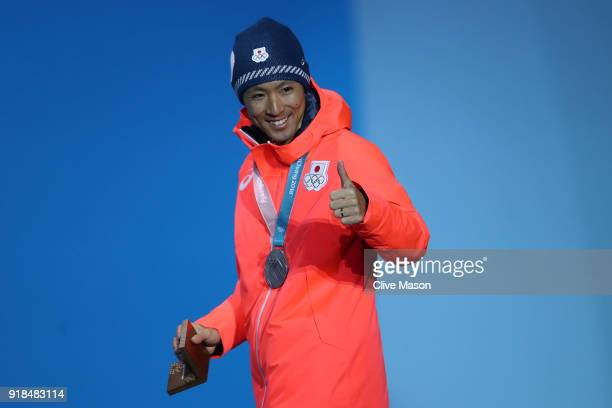Silver medalist Akito Watabe of Japan celebrates during the medal ceremony for the Nordic Combined Individual Gundersen NH/10km on day six of the...