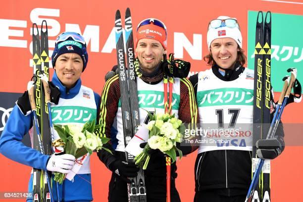 Silver medalist Akito Watabe of Japan gold medalist Bjoern Kircheisen of Germany and bronze medalist Mikko Kokslein of Norway celebrate on the podium...
