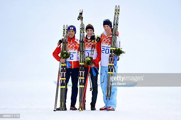 Silver medalist Akito Watabe of Japan gold medalist Eric Frenzel of Germany and bronze medalist Magnus Krog of Norway after the flower ceremony for...