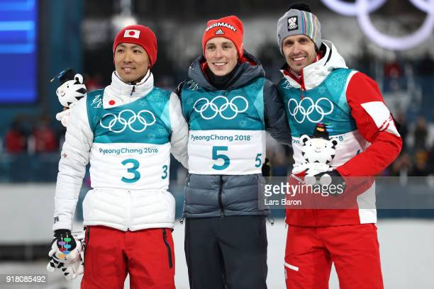 Silver medalist Akito Watabe of Japan gold medalist Eric Frenzel of Germany and bronze medalist Lukas Klapfer of Austria celebrate on the podium...