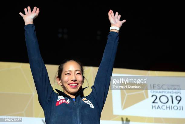 Silver medalist Akiyo Noguchi of Japan celebrates on the podium at the medal ceremony for the Women's Combined on day ten of the IFSC Climbing World...