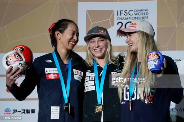 Silver medalist Akiyo Noguchi of Japan gold medalist Janja Garnbret of Slovenia and bronze medalist Shauna Coxsey of Great Britain smile on the...