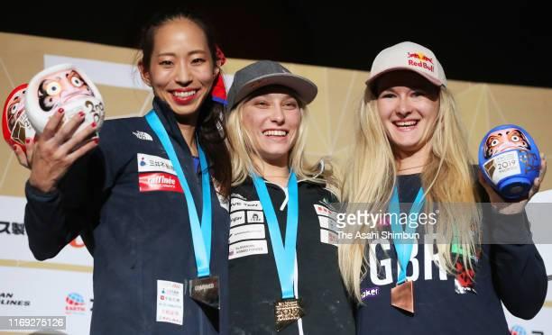 Silver medalist Akiyo Noguchi of Japan gold medalist Janja Garnbret of Slovenia and bronze medalist Shauna Coxsey of Great Britain pose on the podium...