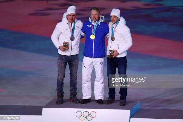 Silver medalist Aleksandr Bolshunov of Olympic Athlete from Russia gold medalist Iivo Niskanen of Finland and bronze medalist Andrey Larkov of...
