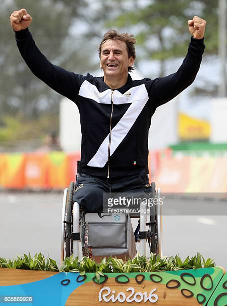 Silver medalist Alessandro Zanardi of Italy celebrates on the podium at the medal ceremony for the Men's Road Race H5on day 8 of the Rio 2016...