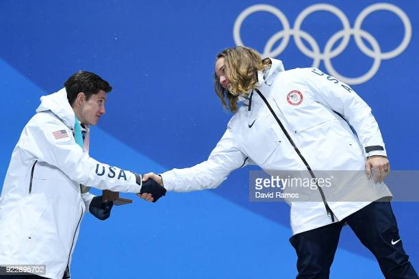 Silver medalist Alex Ferreira of the United States and gold medalist David Wise of the United States shake hands during the medal ceremony for...