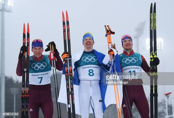 Silver medalist Alexander Bolshunov of Olympic Athlete from Russia gold medalist Iivo Niskanen of Finland and bronze medalist Andrey Larkov of...
