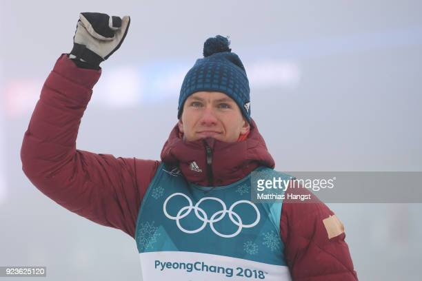 Silver medalist Alexander Bolshunov of Olympic Athlete from Russia celebrates during the victory ceremony after the Men's 50km Mass Start Classic on...