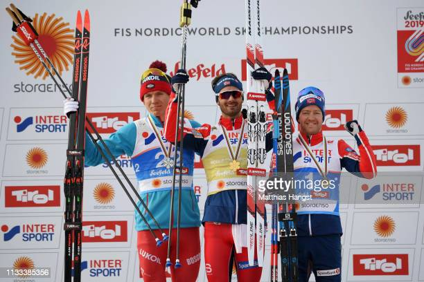 Silver medalist Alexander Bolshunov of Russia gold medalist Hans Christer Holund of Norway and bronze medalist Sjur Roethe of Norway celebrates...