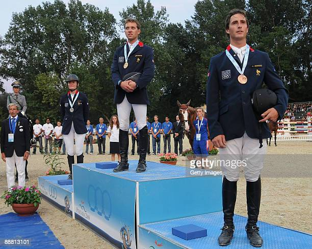 Silver medalist Alexandra Francart on her horse Rush D'Hoogpoort gold medalist Simon Delestre on his horse Melodie Ardente and Julien Gonin on his...