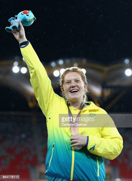Silver medalist Alexandra Hulley of Australia celebrates during the medal ceremony for the Women's Hammerduring the Athletics on day six of the Gold...