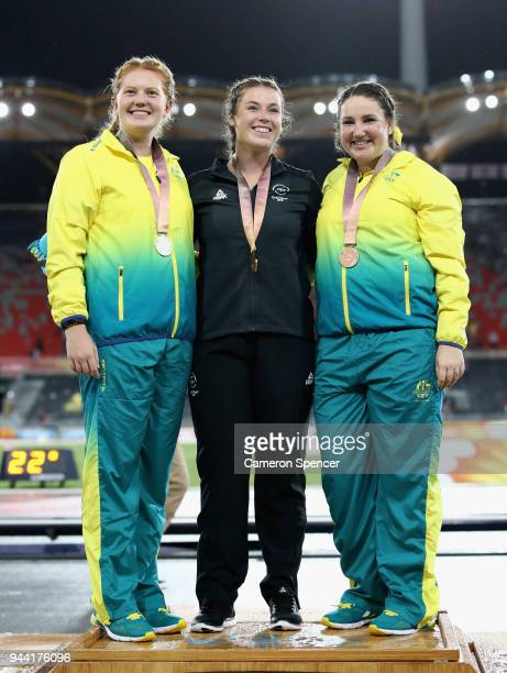 Silver medalist Alexandra Hulley of Australia gold medalist Julia Ratcliffe of New Zealand and bronze medalist Lara Nielsen of Australia pose during...