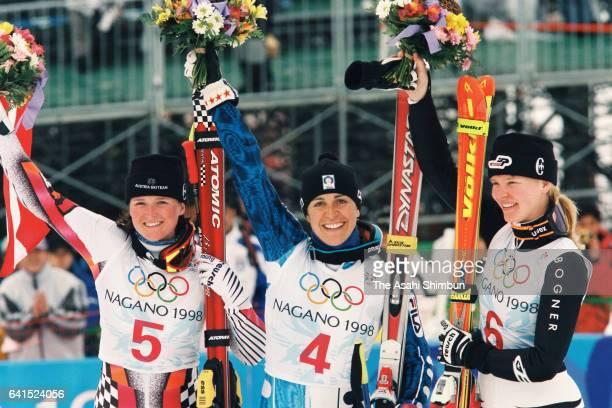 Silver medalist Alexandra Meissnitzer of Austia gold medalist Deborah Compagnoni of Italy and bronze medalist Katja Seizinger of Germany celebrate on...