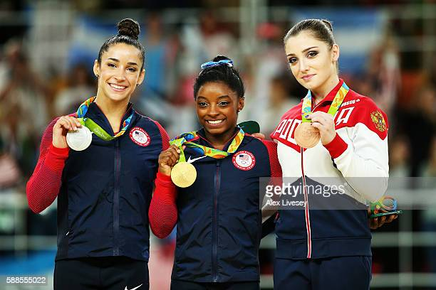 silver medalist Alexandra Raisman of the United States gold medalist Simone Biles of the United States and bronze medalist Aliya Mustafina of Russia...