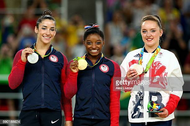 Silver medalist Alexandra Raisman of the United States gold medalist Simone Biles of the United States and Amy Tinkler of Great Britain pose for...