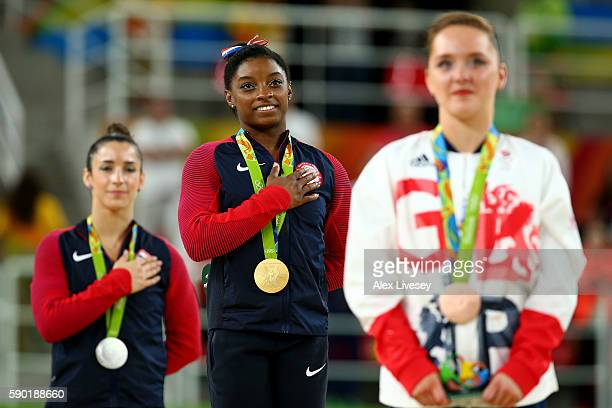 Silver medalist Alexandra Raisman of the United States, gold medalist Simone Biles of the United States and Amy Tinkler of Great Britain stand for...