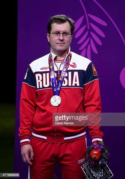 Silver medalist Alexei Klimov of Russia poses with the medal won during the Men's Shooting 25m Rapid Fire Pistol on day nine of the Baku 2015...