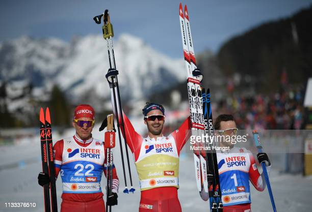 Silver medalist Alexey Chervotkin of Russia gold medalist Hans Christer Holund of Norway and bronze medalist Sjur Roethe of Norway celebrate...