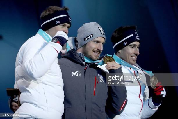 Silver medalist Alexis Pinturault of France gold medalist Marcel Hirscher of Austria and bronze medalist Victor MuffatJeandet of France pose during...