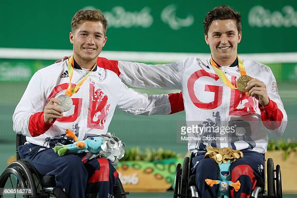 Silver medalist Alfie Hewett and gold medalist Gordon Reid both of Great Britain pose for photographers at the medal ceremony for the Men's Singles...