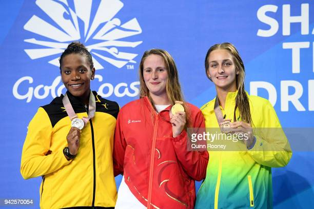 Silver medalist Alia Atkinson of Jamaica gold medalist Sarah Vasey of England and bronze medalist Leiston Pickett of Australia pose during the medal...