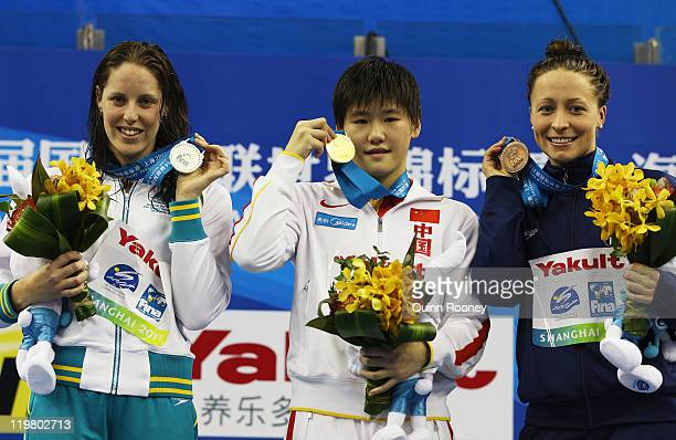 Silver medalist Alicia Coutts of Australia gold medalist Shiwen Ye of China and bronze medalist Ariana Kukors of the United States pose for a photo...