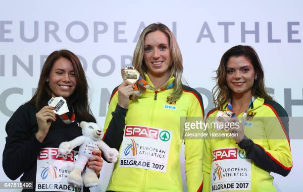 Silver medalist Alina Talay of Belarus gold medalist Cindy Roleder of Germany and bronze medalist Pamela Dutkiewicz of Germany pose during the medal...