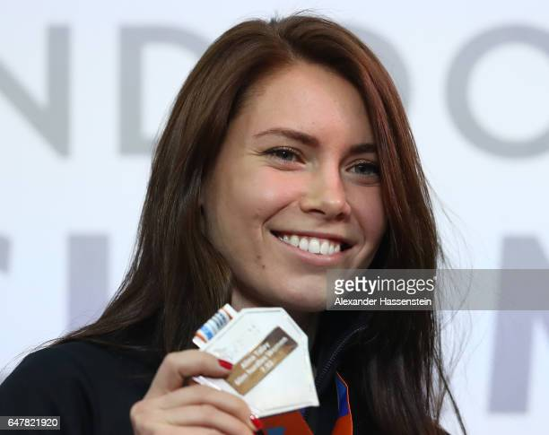 Silver medalist Alina Talay of Belarus poses during the medal ceremony for the Women's 60 metres hurdles on day two of the 2017 European Athletics...