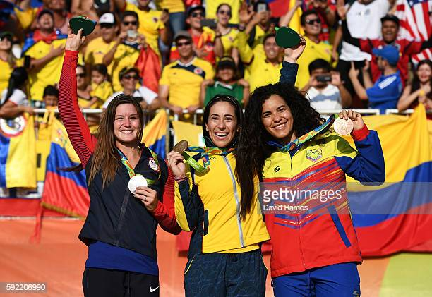 R] Silver medalist Alise Post of USA gold medalist Mariana Pajon of Colombia and bronze medalist Stefany Hernandez of Venezuela on the podium after...