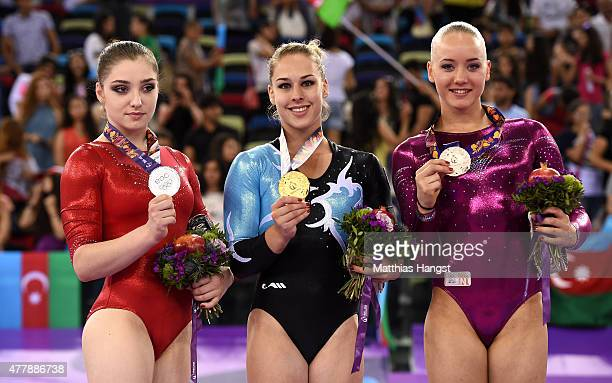 Silver medalist Aliya Mustafina of Russia gold medalist Giulia Steingruber of Switzerland and bronze medalist Lieke Wevers of the Netherlands pose on...