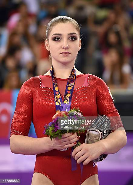 Silver medalist Aliya Mustafina of Russia poses on the medal podium for the Women's Artistic Gymnastics Individual Floor Final during day eight of...