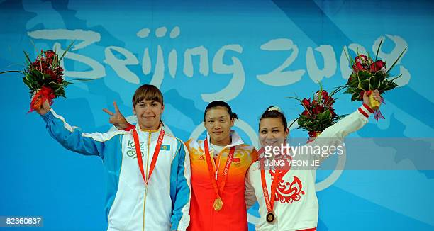 Silver medalist Alla Vazhenina of Kazakhstan gold medalist Cao Lei of China and bronze medalist Nadezda Evstyukhina of Russia pose during the medal...