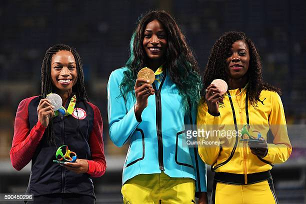 Silver medalist Allyson Felix of the United States, gold medalist Shaunae Miller of the Bahamas and bronze medalist Shericka Jackson of Jamaica pose...