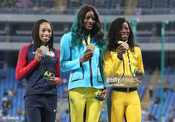 Silver medalist Allyson Felix of USA gold medalist Shaunae Miller of Bahamas and bronze medalist Shericka Jackson of Jamaica pose during the medal...