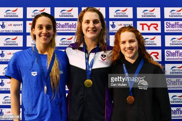 Silver medalist Alys Thomas of Swansea Aq gold medalist Charlotte Atkinson of Loughboro Uni and bronze medalist Emily Large of Newcastle pose with...