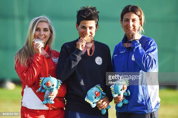 Silver medalist Amber Hill of England gold medalist Andri Eleftheriou of Cyprus and bronze medalist Panagiota Andreou pose during the Women's Skeet...