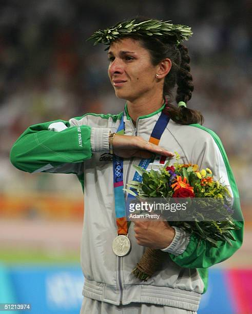 Silver medalist Ana Guevara of Mexic celebrates on the podium during the medal ceremony of the women's 400 metre medal ceremony on August 24 2004...