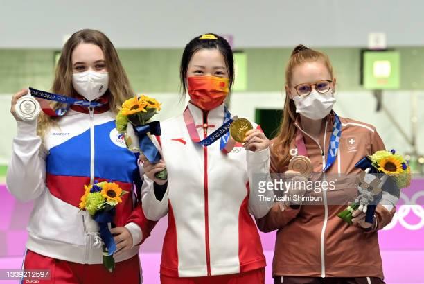 Silver Medalist Anastasiia Galashina of Team ROC, Gold Medalist Qian Yang of Team China, and Bronze Medalist Nina Christen of Team Switzerland pose...