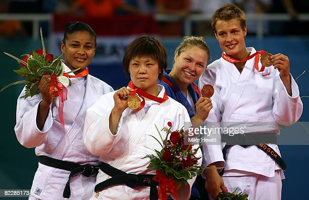 Silver medalist Anaysi Hernandez of Cuba gold medalist Masae Ueno of Japan and bronze medalists Ronda Rousey of the USA and Edith Bosch of the...