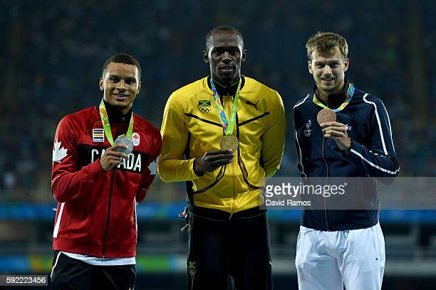 Silver medalist Andre De Grasse of Canada gold medalist Usain Bolt of Jamaica and bronze medalist Christophe Lemaitre of France pose on the podium...