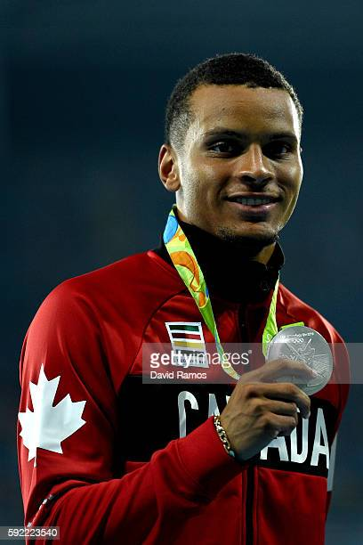 Silver medalist Andre De Grasse of Canada poses on the podium during the medal ceremony for the Men's 200m on Day 14 of the Rio 2016 Olympic Games at...