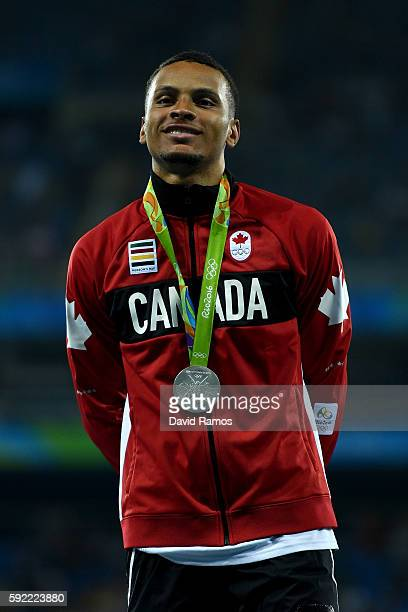 Silver medalist, Andre De Grasse of Canada, poses on the podium during the medal ceremony for the Men's 200m on Day 14 of the Rio 2016 Olympic Games...