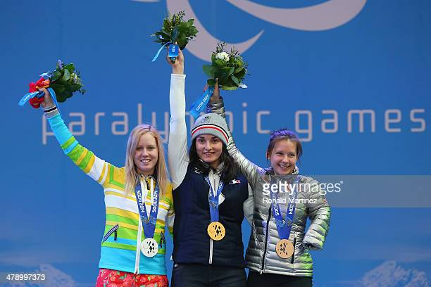 Silver medalist Andrea Rothfuss of Germany gold medalist Marie Bochet of France and bronze medalist Stephanie Jallen of the United States celebrate...