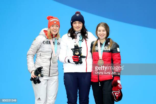 Silver medalist Andrea Rothfuss of Germany Gold medalist Marie Bochet of France and bronze medalist Mollie Jepsen of Canada pose for the medal...