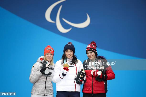 Silver Medalist Andrea Rothfuss of Germany Gold Medalist Marie Bochet of France and Bronze Medalist Alana Ramsay of Canada pose during the victory...