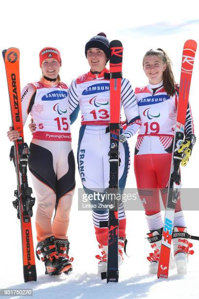 Silver medalist Andrea Rothfuss of Germany Gold Medalist Marie Bochet of France and Mollie Jepsen of Canada celebrates at the victory ceremony for...