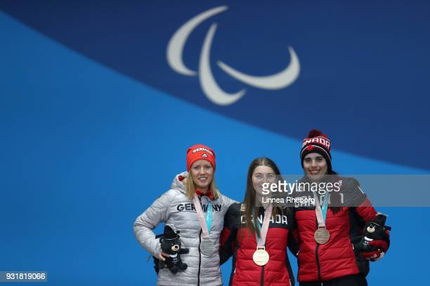 Silver medalist Andrea Rothfuss of Germany gold medalist Mollie Jepsen of Canada and Alana Ramsey of Canada celebrates during the medal ceremony for...