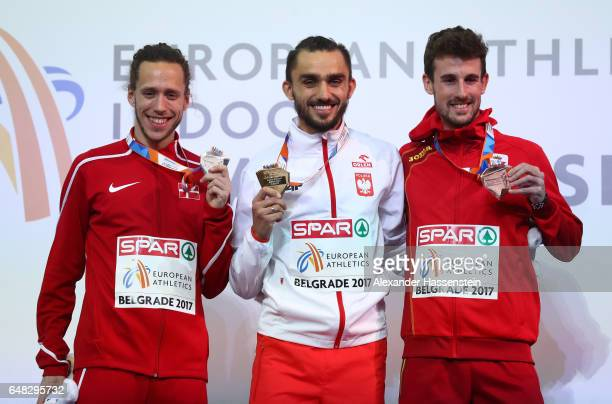 Silver medalist Andreas Bube of Denmark gold medalist Adam Kszczot of Poland and bronze medalist Alvaro De Arriba of Spain pose during the medal...