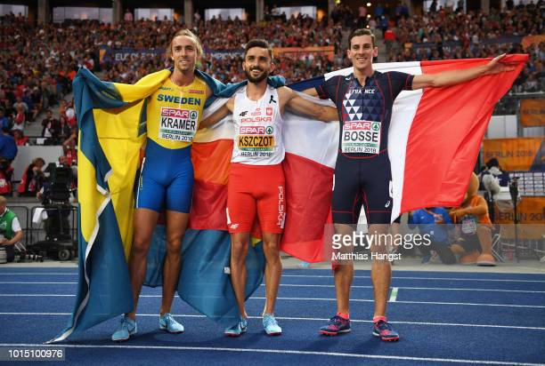 Silver Medalist Andreas Kramer, Gold medalist Adam Kszczot of Poland and Bronze Medalist Pierre-Ambroise Bosse of France celebrate winning their...